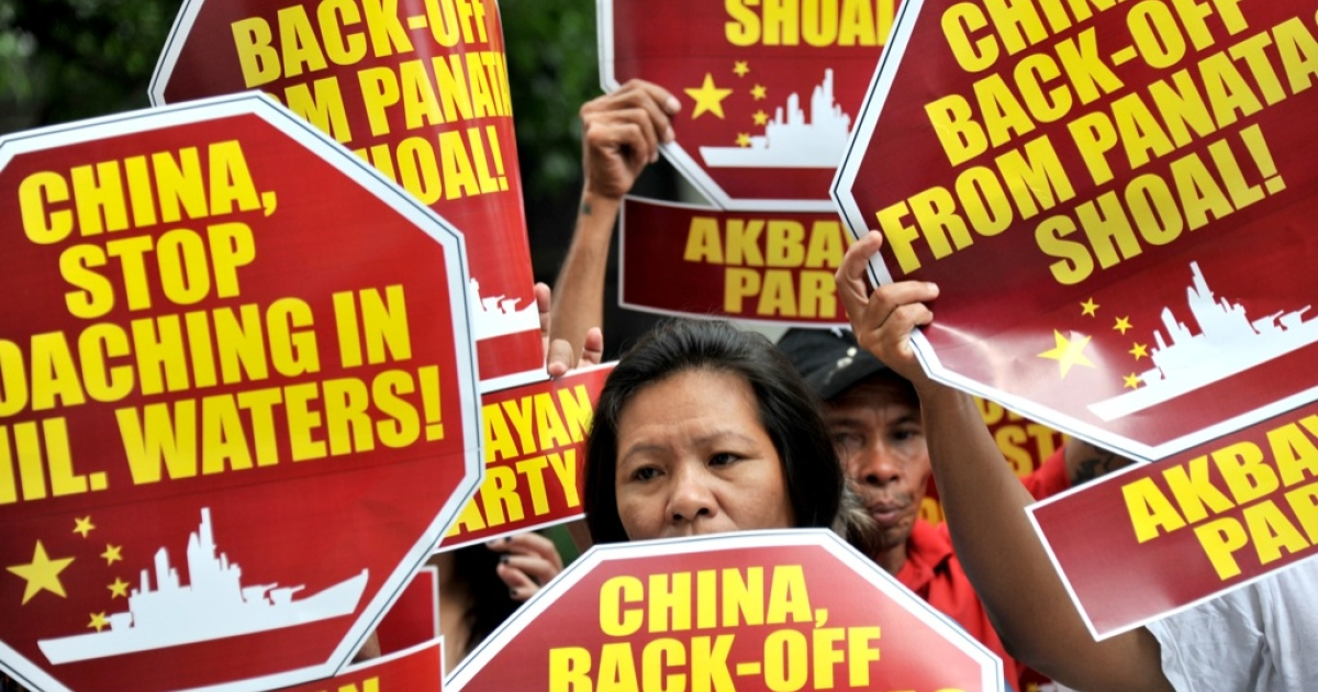 Activists hold a protest in front of the Chinese Consular Office in Manila on April 16, 2012, demanding the Chinese government to immediately pull out from Scarborough Shoal. According to the Philippines said it remained locked in a stalemate with China over a disputed shoal in the South China Sea.</p>