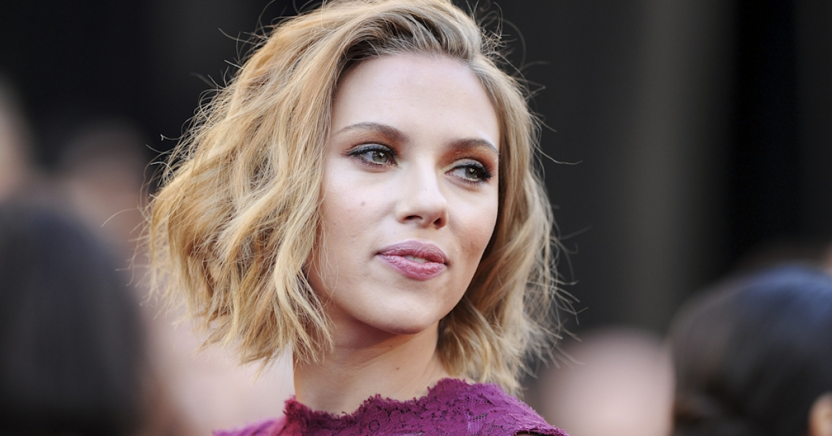 Actress Scarlett Johansson has threatened legal action against anyone who posts the nude photos of her that hit the internet on September 14, 2011. The FBI says it is investigating computer hacking attacks on celebrities.</p>