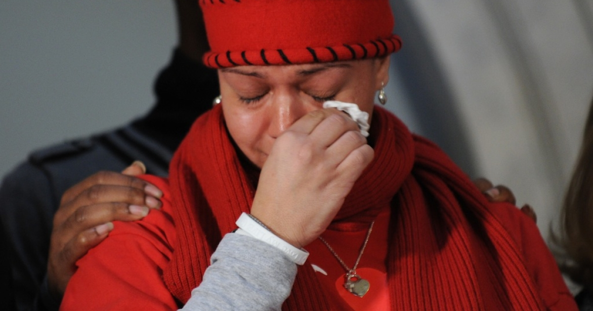 A woman who is a relative of a shooting victim cries as she joins New York City Mayor Michael R. Bloomberg, Martin Luther King, Jr. III, and friends and family members of victims from New York, the Tucson, Arizona, Columbine and Virginia Tech shooting tragedies to urge Congress to fix the background check system for gun sales January 24, 2011 at City Hall in New York.</p>