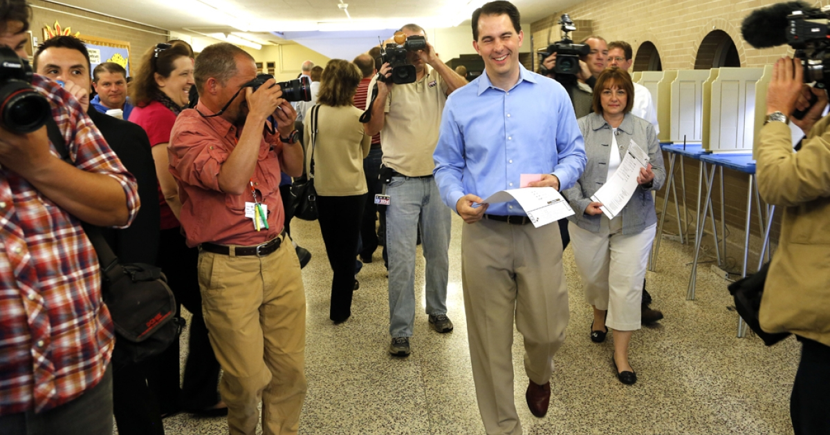 Wisconsin Gov. Scott Walker walks past media after he filled out his ballot at Jefferson School to vote in the gubernatorial recall election June 5, 2012 in Wauwatosa, Wisconsin. Voters were lined up before the polls opened at 7 a.m. to decide on the recall race between the Republican Walker and Democratic Milwaukee Mayor Tom Barrett.</p>