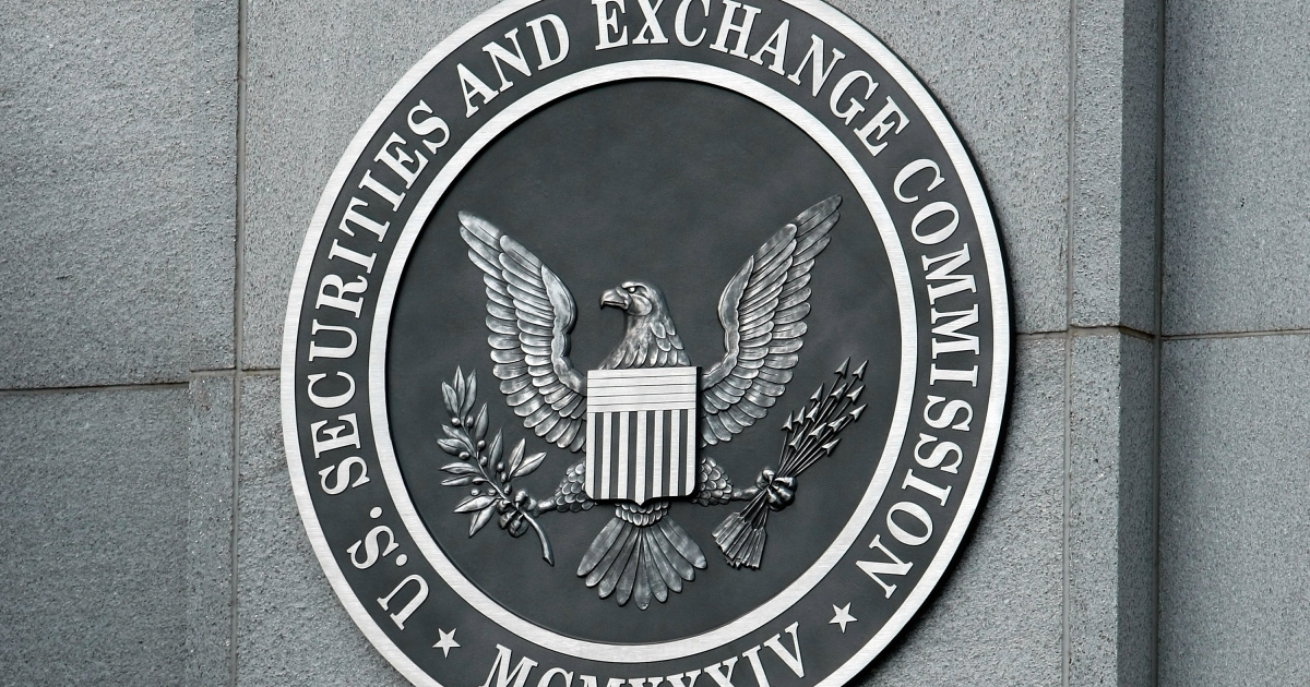 The US Securities and Exchange Commission seal hangs on the facade of its building in Washington, DC.</p>