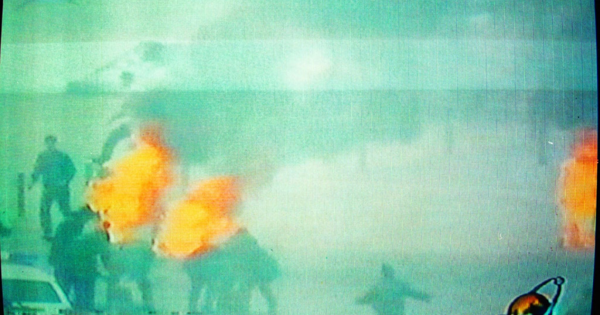 Chinese television footage shows what it describes as Falun Gong members setting themselves on fire, Jan. 23, 2001 in Beijing's Tiananmen Square.</p>