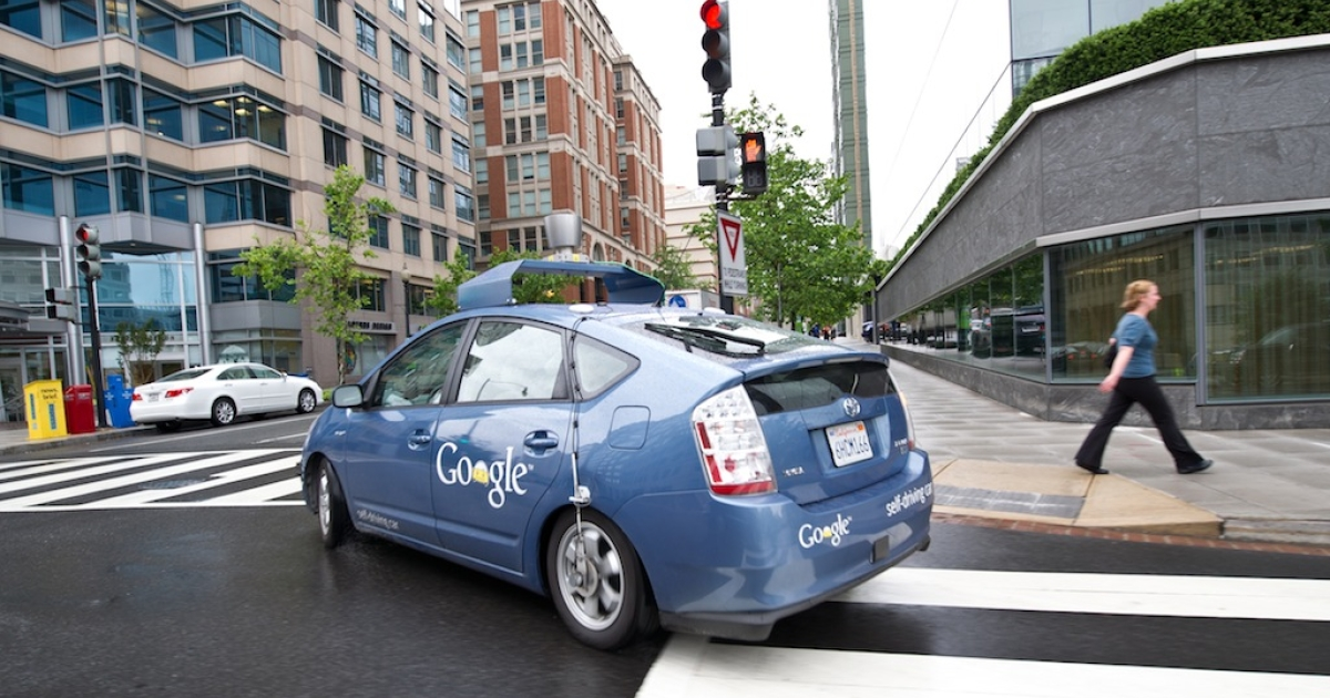 The Google self-driving car maneuvers through the streets of in Washington, DC May 14, 2012. The system on a modified Toyota Prius combines information gathered from Google Street View with artificial intelligence software that combines input from video cameras inside the car, a LIDAR sensor on top of the vehicle, radar sensors on the front of the vehicle and a position sensor attached to one of the rear wheels that helps locate the car's position on the map. Google expects that the increased accuracy of its automated driving system could help reduce the number of traffic-related injuries and deaths, while using energy and space on roadways more efficiently.</p>