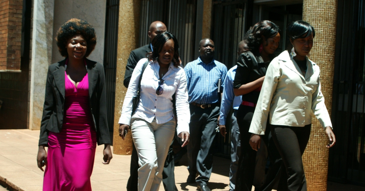 Sisters Sophie Nhokwara (26), Netsai Nhokwara (24) and Rosemary Chakwizira (28) leave Harare Magistrates court on November 29, 2011 after a pre-trial hearing for attacking male hitchhikers to collect semen for rituals. Prosecutors on May 3, 2012, said they were dropping charges against the women for lack of evidence.</p>