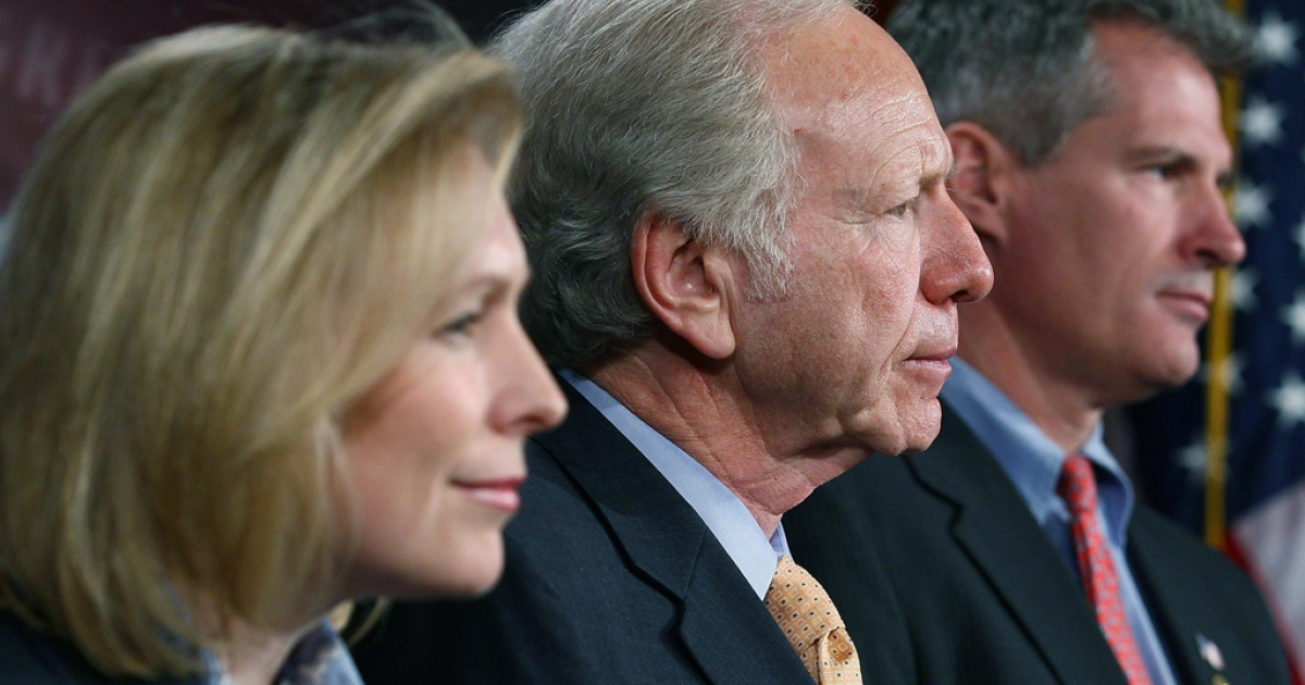 Sens. Kirsten Gillibrand, Joe Lieberman and Scott Brown participate in a during a news conference on Congressional insider trading on January 31, 2012. The Senate passed the Stop Trading on Congressional Knowledge Act by a margin of 96 to 3 on March 22, 2012.</p>