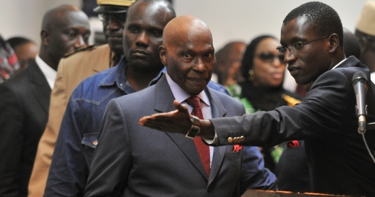 Senegalese President Abdoulaye Wade arrives on February 27, 2012 for a public declaration at the presidential palace in Dakar. Wade accepted the possibility he may have to head to a runoff in his bid for a third term. He said with half of the votes counted, he was ahead with 32.17 percent, and the runner-up at 25.24 percent.</p>
