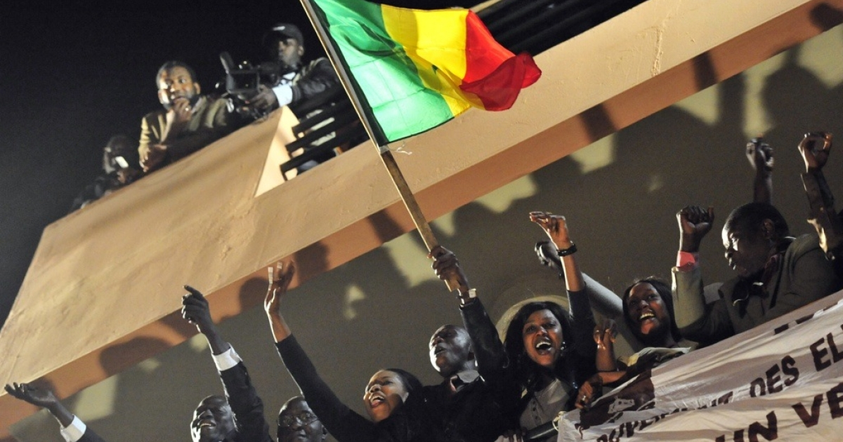 Supporters of Senegalese opposition leader Macky Sall celebrate the news that President Abdoulaye Wade conceded defeat on March 25, 2012.</p>