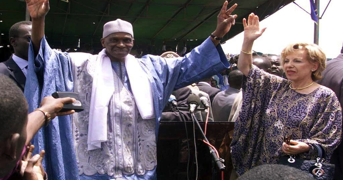 Senegalese President Abdoulaye Wade and his French wife Viviane wave to supporters during the investiture congress of the ruling Senegalese Democratic Party for the upcoming legislative elections, on Mar. 31, 2001 at Demba Diop stadium in Dakar.</p>