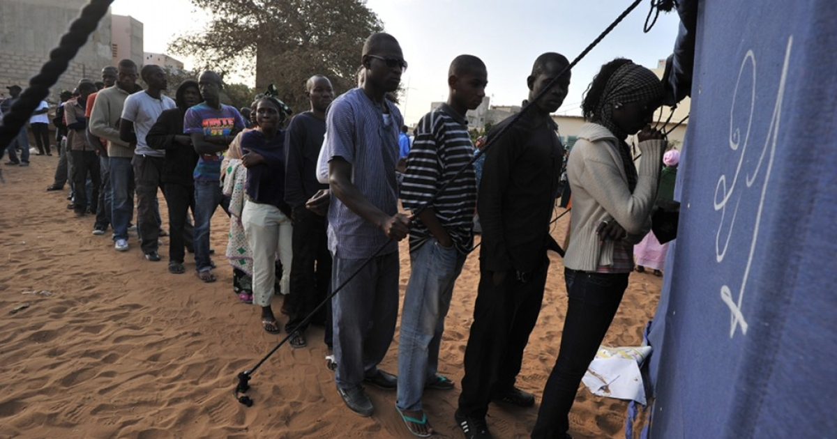 People queue to cast their votes on February 26, 2012 at a polling station in Dakar during Senegal's most contentious election yet as President Abdoulaye Wade seeks a disputed third term.</p>