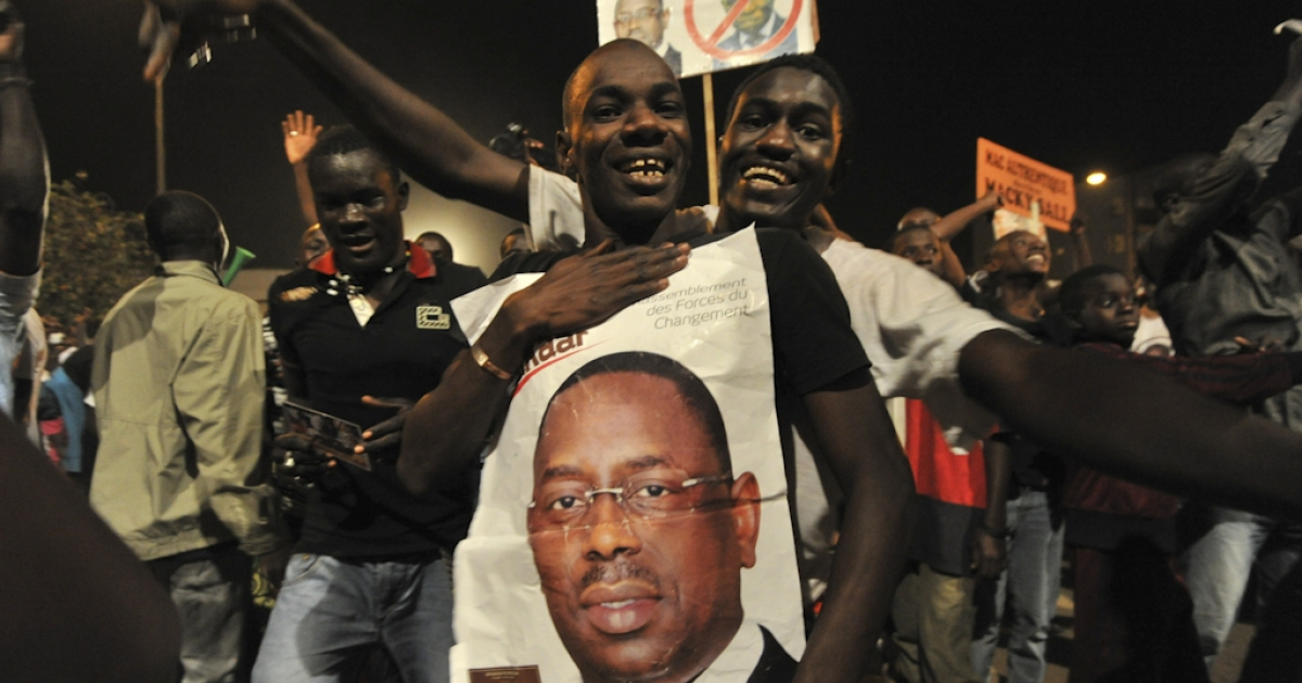 Opposition challenger Macky Sall supporters celebrates their candidate victory at the their campaign headquarter in Dakar March 25, 2012.  Senegal's President Abdoulaye Wade admitted defeat in the presidential election Sunday evening as results gave an overwhelming lead to his rival Macky Sall, state media reported.  The Senegalese Press Agency said Wade