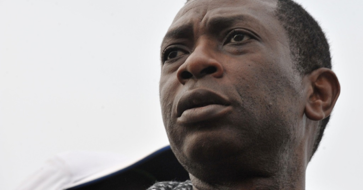 Senegalese music icon Youssou Ndour attends a demonstration demanding that President Abdoulaye Wade drop plans to seek a third term on January 31, 2012 in Dakar. Senegal riot police fired tear gas and sprayed protesters with water to break up the thousands-strong rally</p>