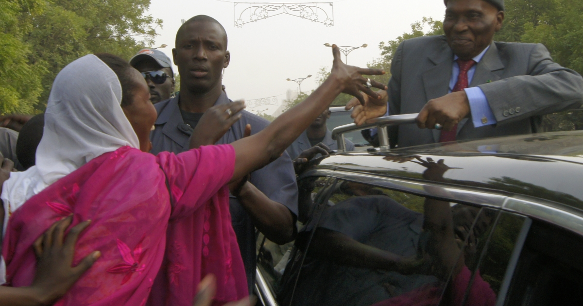 Senegal's President Abdoulaye Wade is greeted by supporters in the streets of Dakar on Feburary 7, 2012. Thousands of opposition supporters marched through central Dakar Tuesday to ratchet up the pressure on the president to abandon his bid for a third term in office.</p>