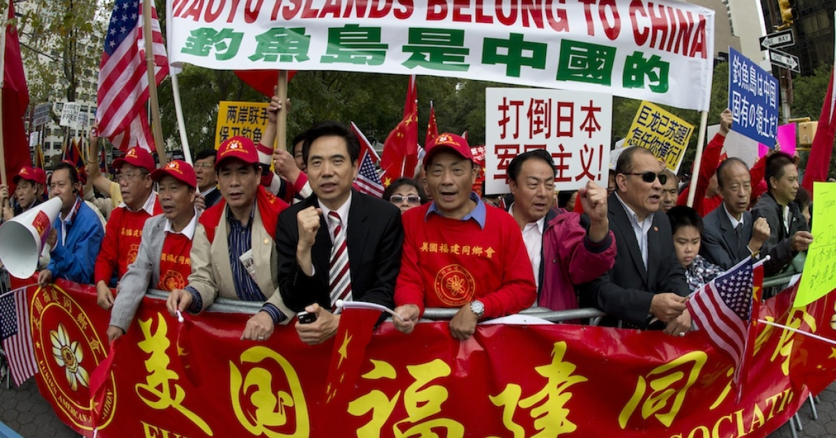 Demonstrators believing that the Diaoyu Islands belong to China, protest across the street from the United Nations, during the 67th United Nations General Assembly meeting, Sept. 26, 2012 in New York.</p>