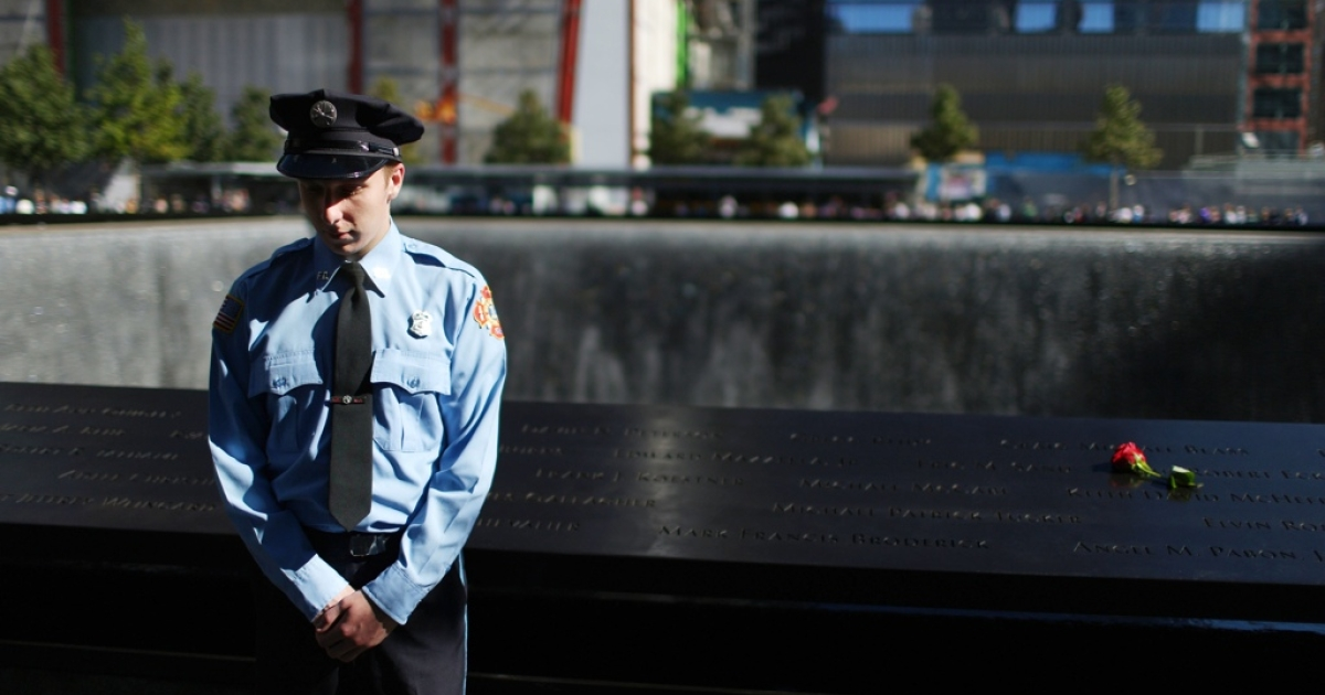 Zachary Ellicott, who lost a family member Keith James Burns, observes a moment of silence for US Flight 93 that crashed near Shanksville, Pennsylvania, during memorial ceremonies to mark the Sept. 11, 2001 attacks. New York City and the nation are commemorating the 11th anniversary of 9/11.</p>