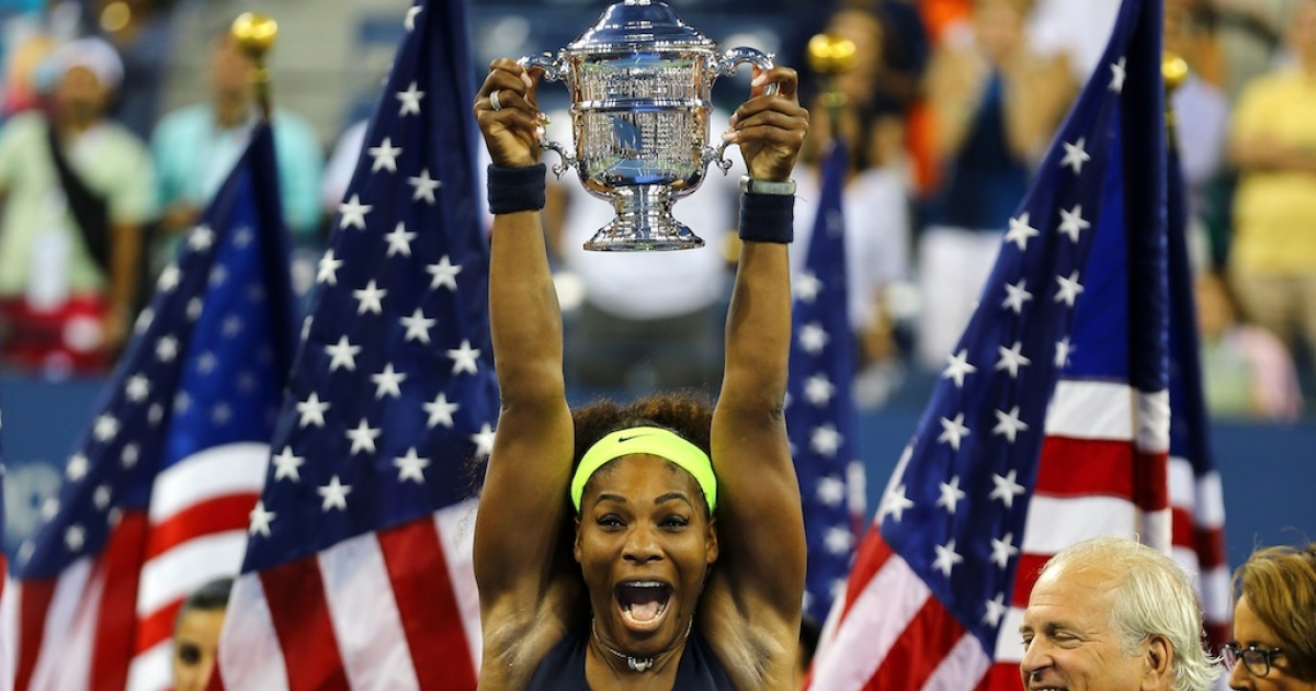 Serena Williams of the United States lifts the championship trophy after defeating Victoria Azarenka of Belarus in the US Open women's singles final today.</p>
