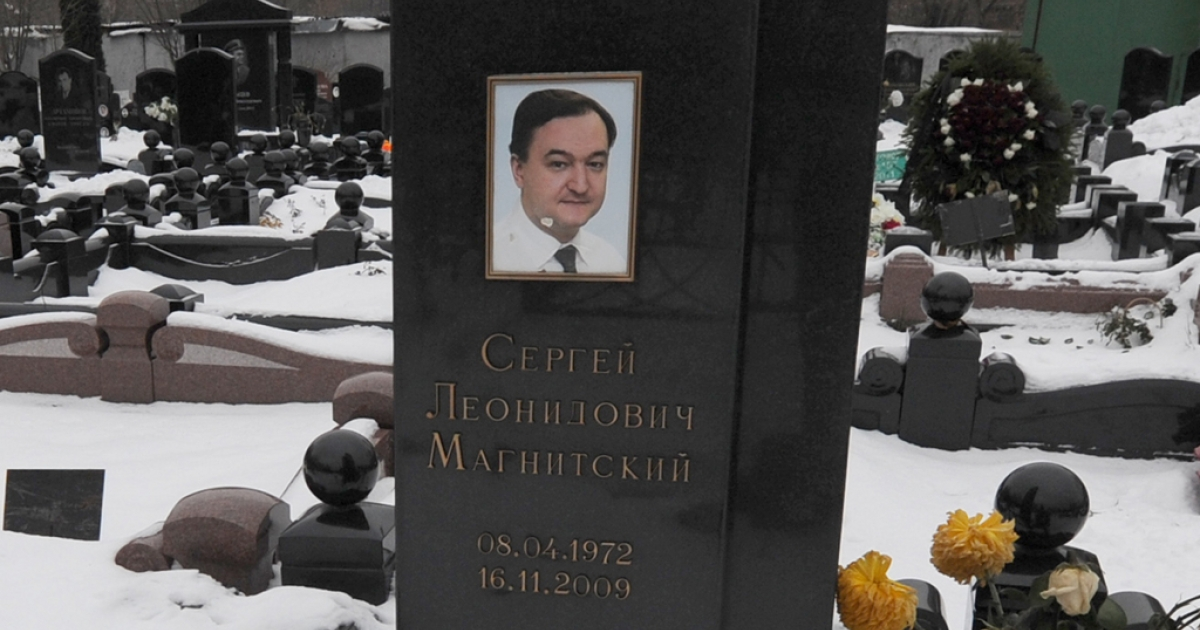 The snow clad grave of Russian lawyer Sergei Magnitsky with his portrait on the tomb at the Preobrazhenskoye cemetery in Moscow.</p>