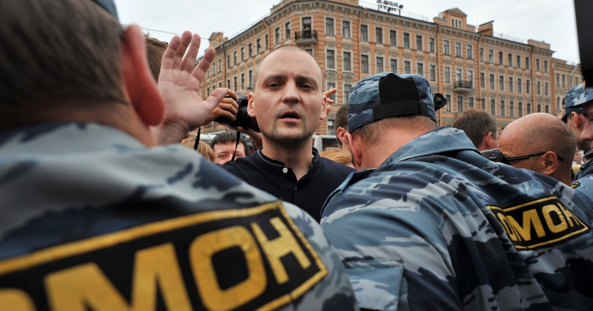 Police detain opposition leader Sergei Udaltsov during an opposition rally in July 2012. The head of the Left Front has been charged with plotting to spread disorder.</p>