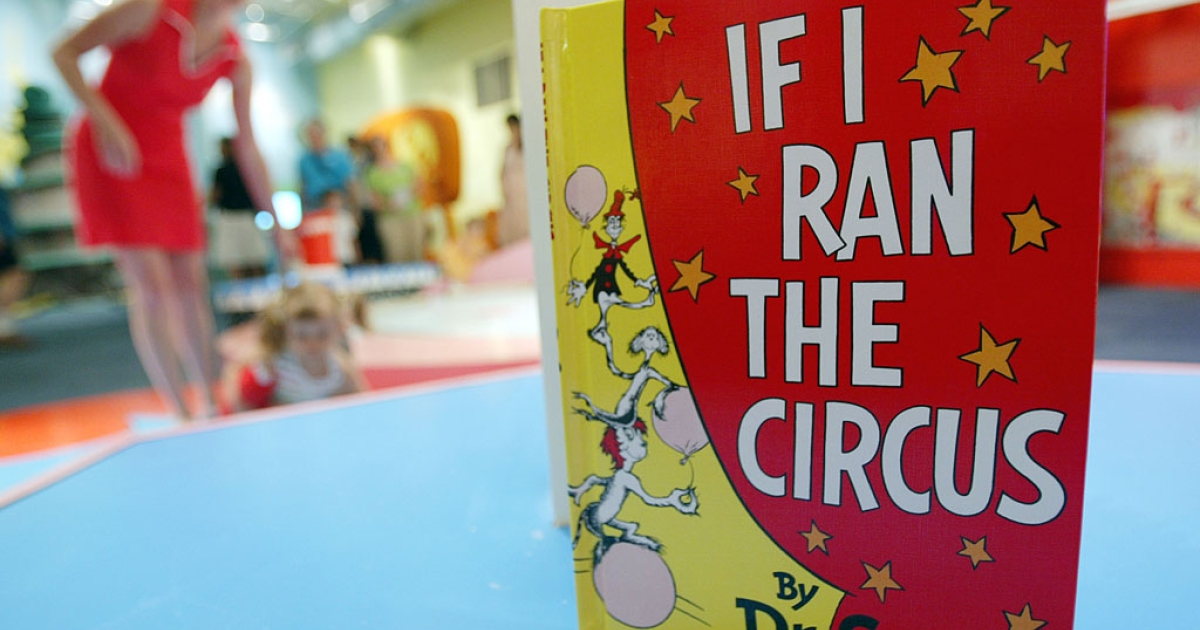 A Dr. Seuss book sits as children play at an exhibition dedicated to Dr. Seuss at the Children's Museum of Manhattan in New York City.</p>