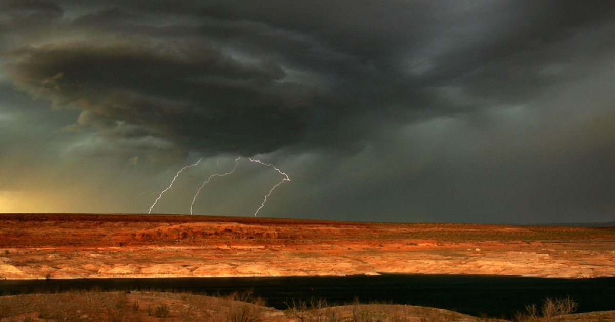 Lightning strikes as a much-needed rain storm comes to Lake Powell near Page, Arizona which is marked by a 100-foot thick