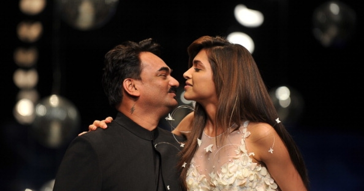 Indian Bollywood actress Deepika Padukone getting dangerously close to a kiss with an Indian designer Wendell Rodricks at the end of the presentation of his collection at the Wills Lifestyle India Fashion Week Spring Summer 2012 in New Delhi on October 10, 2011.</p>