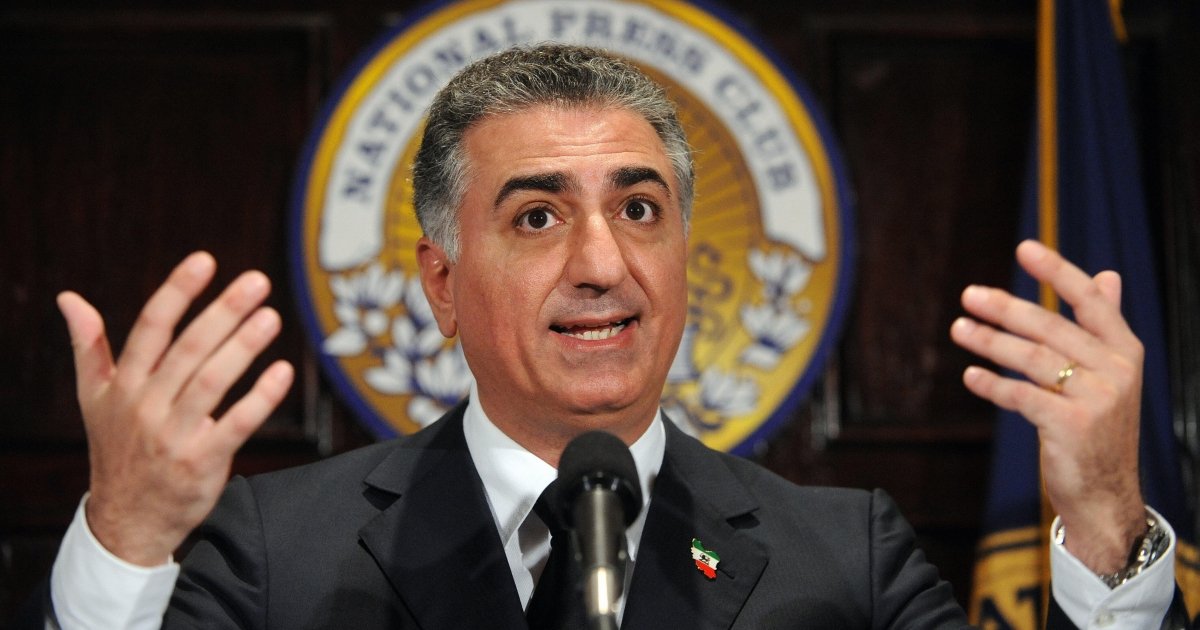 His father's spitting image: Iran's former Crown Prince Reza Pahlavi, an advocate of civil disobedience against the clerical regime in Tehran, holds a news conference in Washington in June, 2009.</p>
