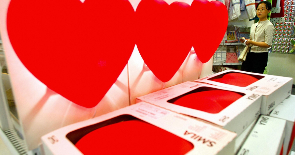 Heart-shaped lamps are sold at an IKEA store in Shanghai. The furniture company finds itself as the new dating hot-spot for senior citizens out looking for either love or friendship.</p>