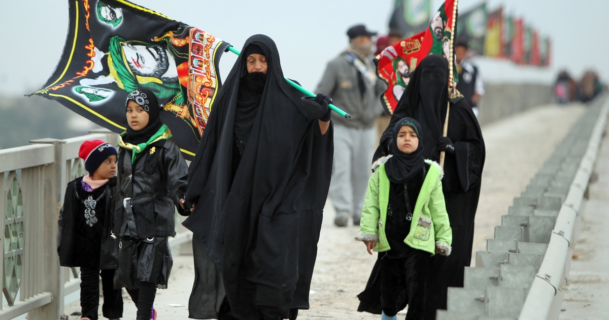 Iraqi Shiite Muslim pilgrims walk on January 6, 2012 through the Dura neighborhood of Baghdad on a main highway linking the Iraqi capital to the central shrine city of Karbala where they will mark the Arbaeen religious festival which is the 40th day after Ashura commemorating the killing of Prophet Mohammed's grandson, Imam Hussein in the seventh century. Two bombs exploded in the morning on separate bridges in the Dura neighborhood of south Baghdad in an Attack against Shiite pilgrims killing two people.</p>