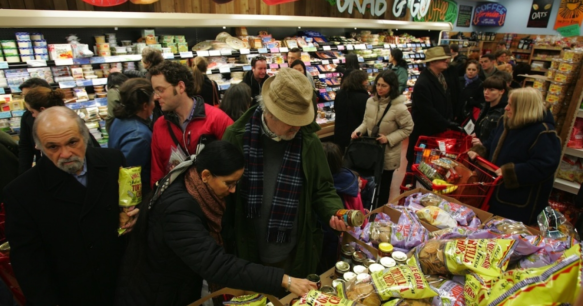 Shoppers line up inside Trader Joe's for the grand opening on 14th Street in New York City on March 17, 2006. Trader Joe's, a specialty retail grocery store, has more than 200 stores in 19 states.</p>