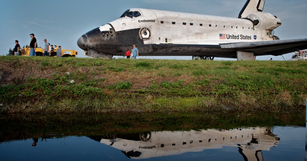 CAPE CANAVERAL, FL - JUNE 1:  Space Shuttle Endeavour is escorted back to a storage building following it's last mission before being retired, at Kennedy Space Center, on June 01, 2011, in Cape Canaveral, Florida. Endeavour will leave Florida on Tuesday to make its final trip to the California Science Center.</p>