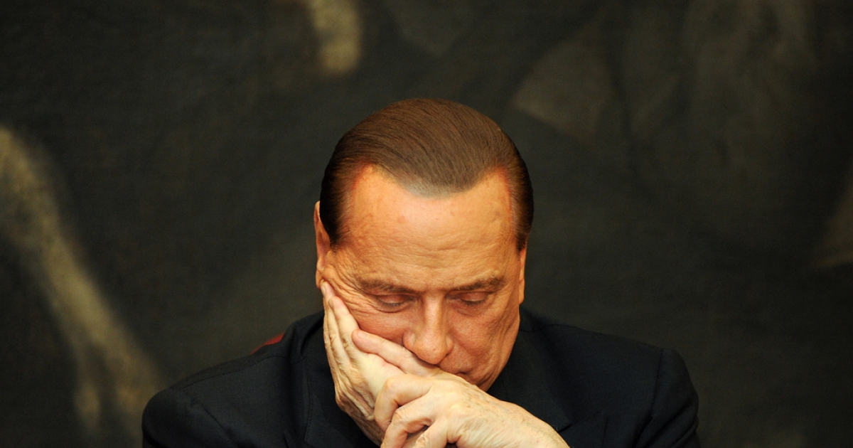 Italy's former Prime Minister Silvio Berlusconi reacts during the presentation of Antonio Razzi's book