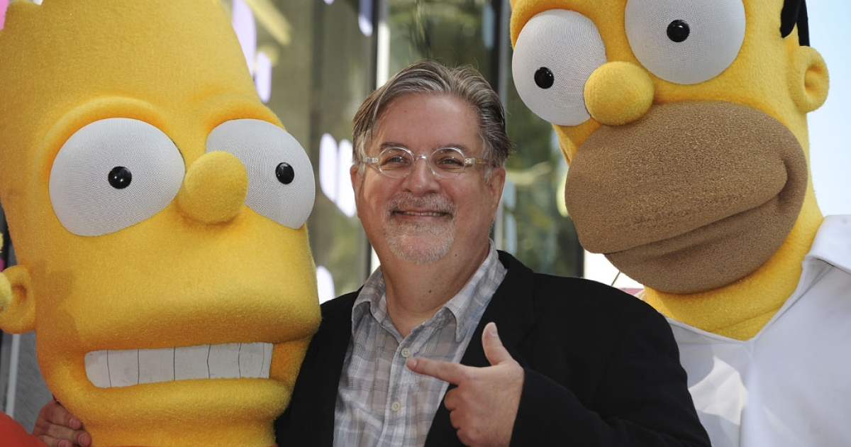 Cartoonist Matt Groening, creator of The Simpsons, poses with Bart and Homer during his Hollywood Walk of Fame ceremony on Feb. 14, 2012, in Hollywood. The 500th episode of the The Simpsons aired on Feb. 19.</p>