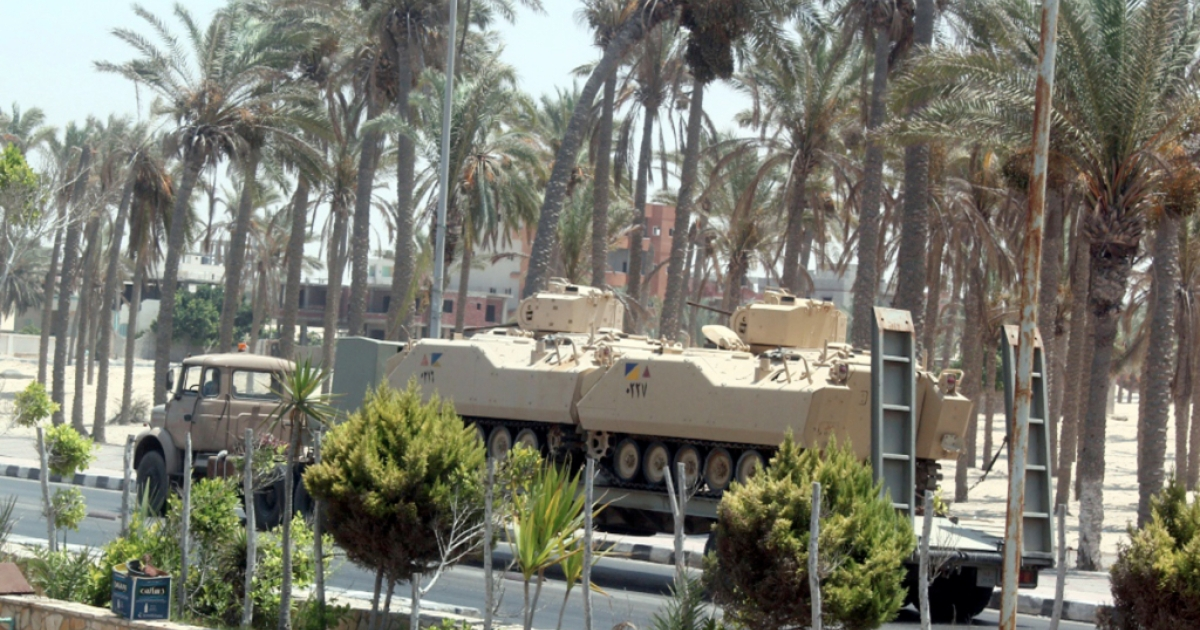 An Egyptian truck carrying armoured vehicles through El-Arish on the Sinai Peninsula in 2011.</p>
