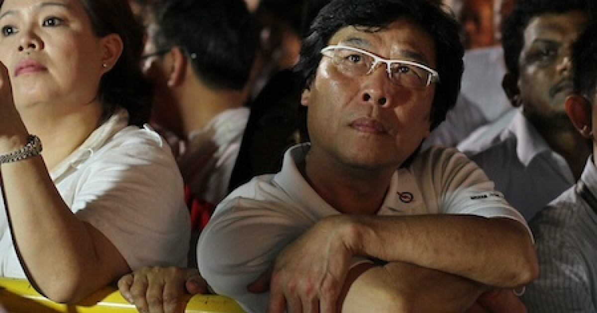 Singapore citizens watch polling results from in the country's 11th elections since independence. The 2011 general election has been the most contested in Singapore's history with 82 seats out of 87 being contested.</p>