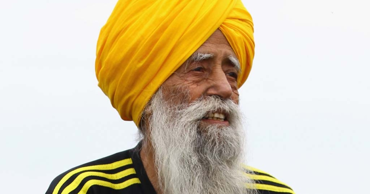 Centenarian Sikh runner Fauja Singh poses for pictures after being the first person to officially enter for next year's Edinburgh Marathon on September 1, 2011 in Edinburgh, Scotland.</p>