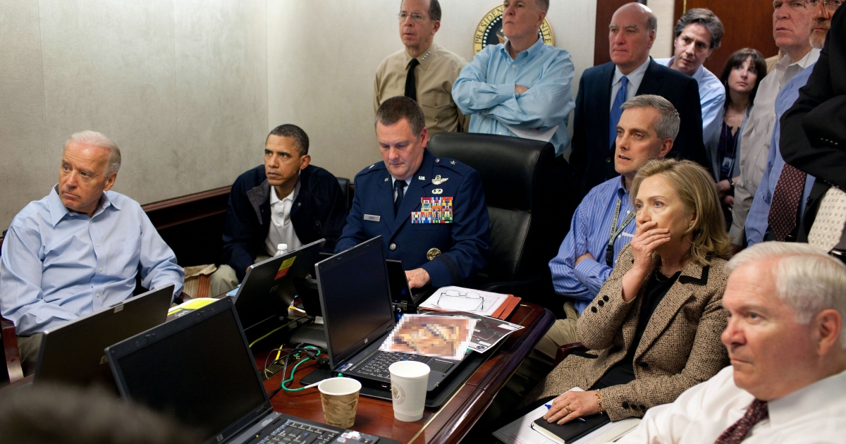 President Barack Obama and Vice President Joe Biden, along with with members of the national security team, receive an update on the mission against Osama bin Laden in the Situation Room of the White House, May 1, 2011.</p>