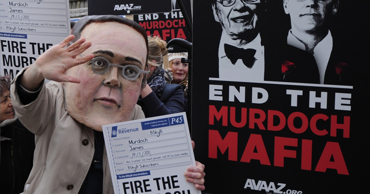 Demonstrators from the campaign group 'Avaaz' protest outside the Queen Elizabeth II centre in London, on November 29, 2011, as BSkyB hold their annual general meeting.</p>