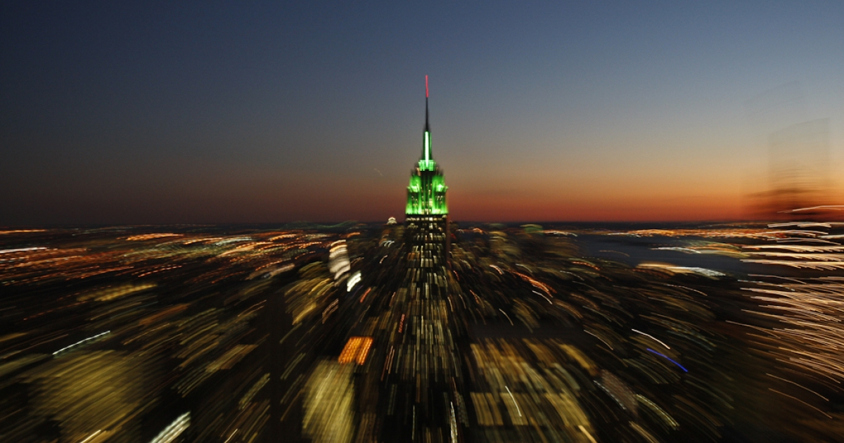 The Empire State Building is illuminated with green lights at sunset in honor of the Muslim holiday Eid-al-Fitr, marking the end of the holy month of Ramadan.</p>