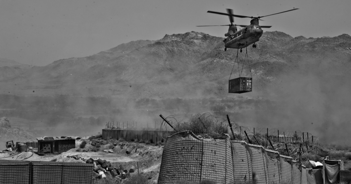 A CH-47 Chinook arrives at Combat Outpost Baylough with a trailer full of supplies for the remote base.</p>