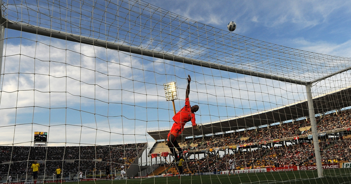 Colombian goalkeeper Luis Martinez jumps to clear a ball during the 2011 Copa America quarter-final football match against Peru, at the Mario Kempes stadium in Cordoba, 770 Km northwest of Buenos Aires, on July 16, 2011.</p>