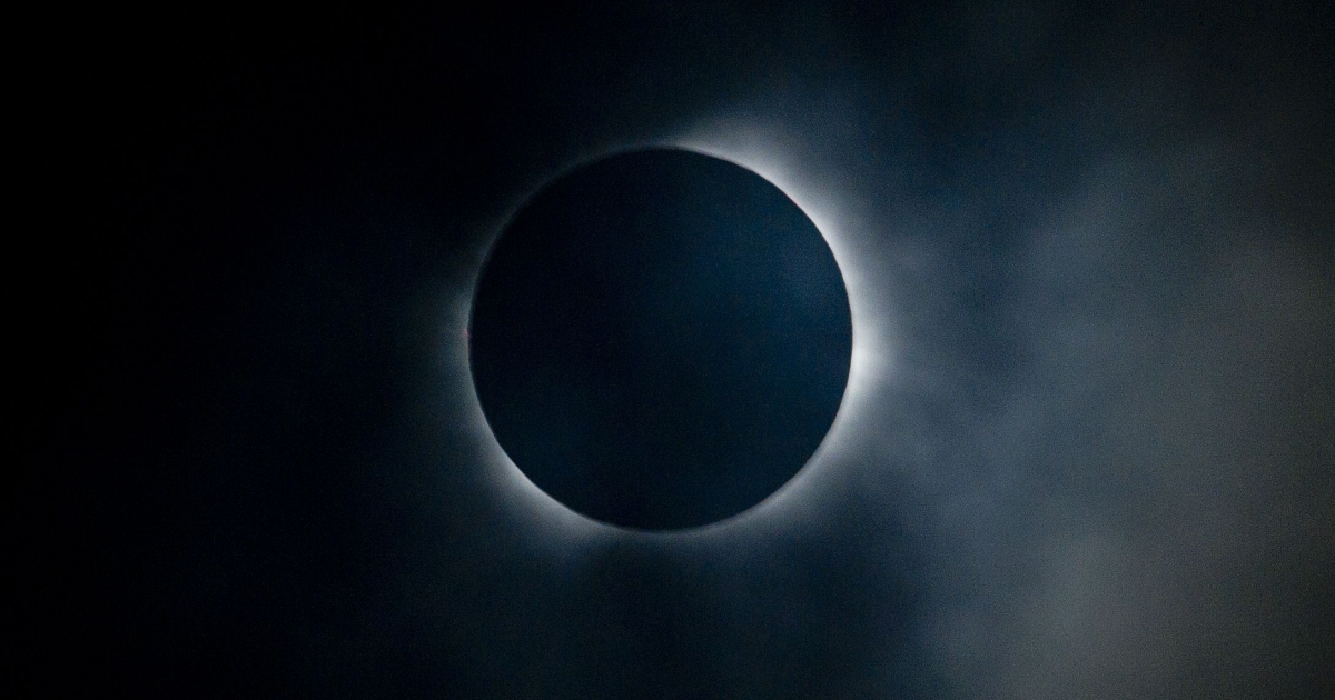 The sun is seen partially covered by the moon on Easter Island, 3700 km off the Chilean coast in the Pacific Ocean, on July 11, 2010.</p>
