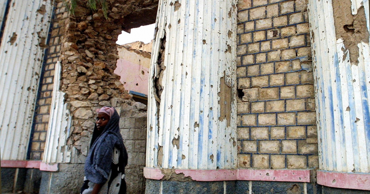 A woman walks past the wall of what used to be Somalia's national theater, which was destroyed by artillery bombardment by Somali National Movement rebels in 1989 who were trying to topple former dictator Muhamed Siad Barre. The Theater re-opened on Monday.</p>