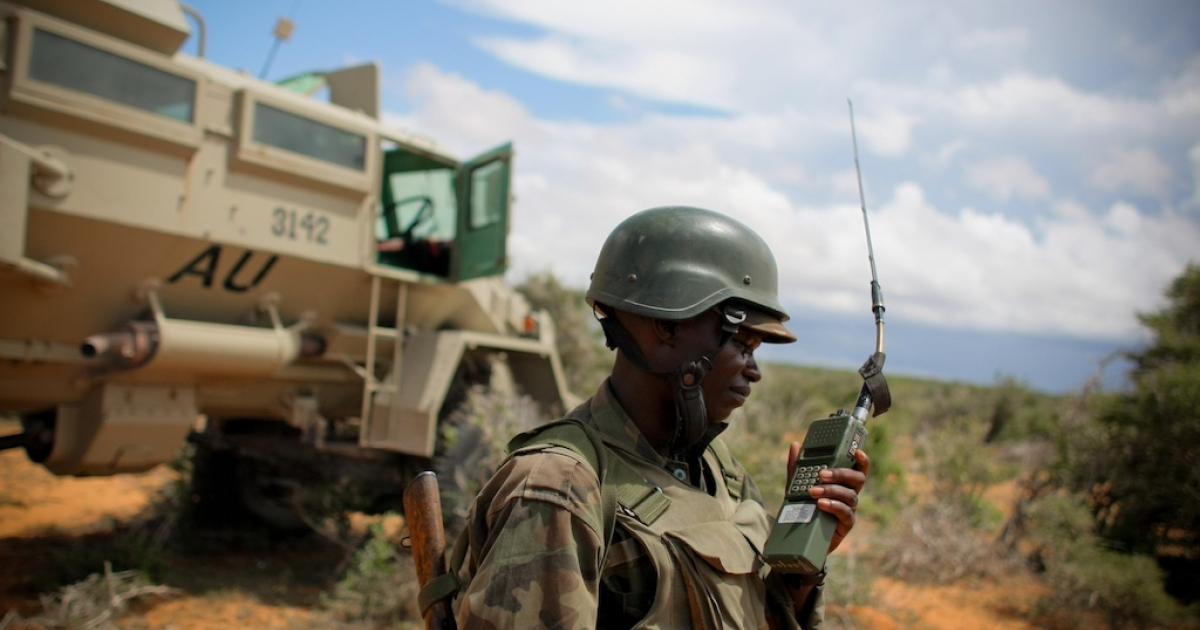 A field commander serving with the African Union Mission in Somalia (AMISOM) walks in front of an armored personnel carrier on May 22, 2012, during a joint AMISOM and Somali National Army (SNA) operation to seize and liberate territory from the Al Qaeda-affiliated extremist group Al Shabaab in the Afgoye region west of Mogadishu.</p>