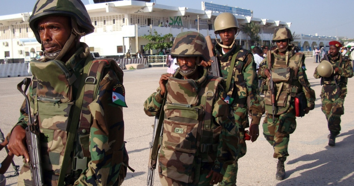 The first African Union contingent from Djibouti arrive at Mogadishu's Adan Ade international airport on December 20, 2011. Somali government officials reported the first contingent consisted of 200 heavily armed troops from Djibouti with more to follow. The troops, who marched out of the airplane in combat uniform and carrying rifles, were welcomed at Mogadishu airport by top Somali military officials and African Union Mission in Somalia (AMISOM) leaders. Djibouti, which neighbors Somalia, is the latest country to deploy troops to Somalia, as regional states use military force to engage the extremist Al Shabaab insurgents of southern Somalia.</p>