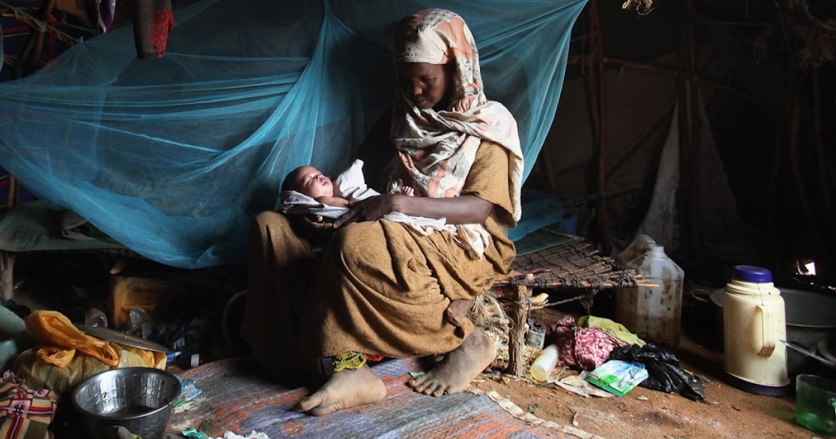 Somalian refugee Baar Abdi Khalif rests in her homemade shelter with her 20-day-old baby on the edge of the giant Dadaab refugee settlement on July 23, 2011 in Dadaab, Kenya. The ongoing civil war in Somalia and the worst drought to affect the Horn of Africa in six decades has resulted in an estimated 12 million people whose lives are threatened.</p>