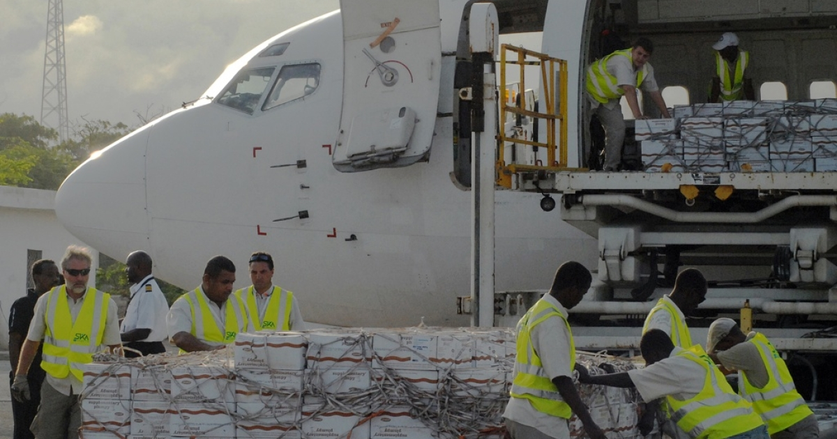 The first airlift of humanitarian food aid arrived at the Aden Abdulle Osman International Airport in Mogadishu, Somalia on July 27, 2011. The World Food Program airlifted 10 tons of emergency supplies to Mogadishu to feed thousands of malnourished children in drought-hit Somalia. Somalia is the country worst affected by the Horn of Africa's prolonged drought - the region's worst in 60 years - that has put some 12 million people in danger of starvation. But Somalia's Al Shabaab rebels are blocking distribution of food aid.</p>