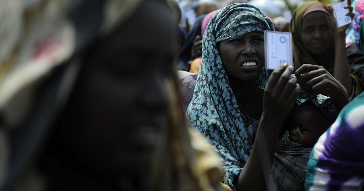 Women displaced from southern Somalia by famine sit in a camp for internally displaced people in Mogadishu waiting for aid supplies. The UN on Feb. 3, 2012, said that famine conditions have ended in Somalia, six months after first being declared.</p>