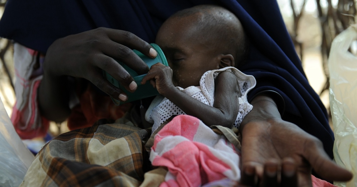 A newly displaced Somali mother feeds her severely malnourished baby with sugary water to restore energy at a feeding center in Doolow, southwestern Somalia. U.N. refugee agency chief Antonio Guterres said that relief groups should increase aid to war-battered and drought-hit Somalis to reduce the exodus to neighboring countries.</p>