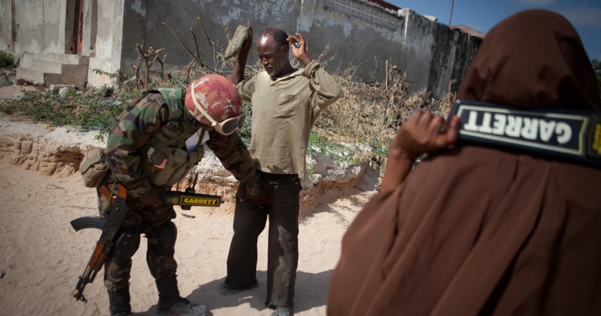 Civilians are searched thoroughly before entering the AMISOM-run local hospital. Security remains tight throughout the city.</p>