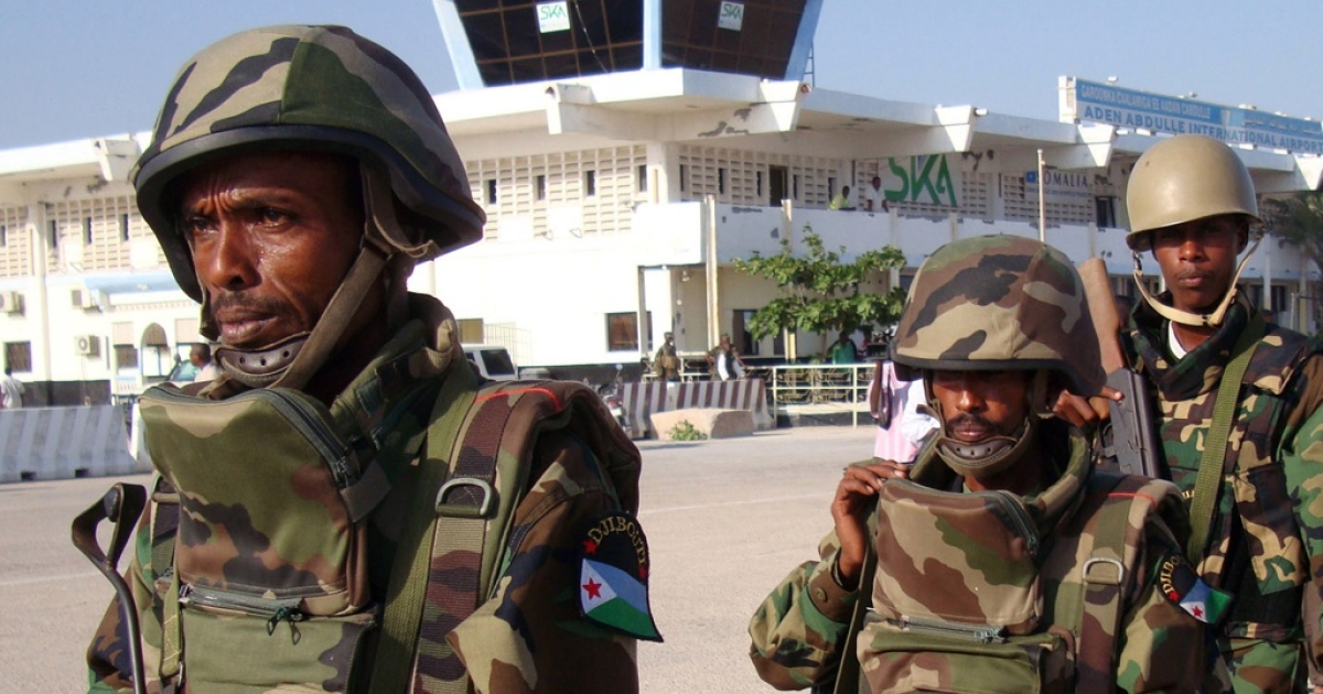 A British man was arrested at Mogadishu airport after saying that he intended to travel to Kismayo. These African Union soldiers did not arrest the man, but are shown with Mogadishu's Adan Ade international airport on December 20, 2011.</p>