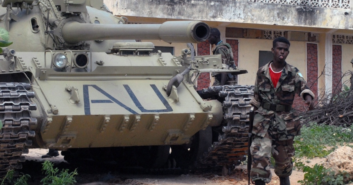 A Somali government soldier walks past a tank belonging to the African Union peacekeepers near the frontline during heavy fighting against Al Shabaab insurgents on July 29, 2011. Fighting erupted the previous day near Mogadishu's key Bakara market and Suqbacad areas, with the two sides exchanging heavy machine gun and artillery fire.</p>